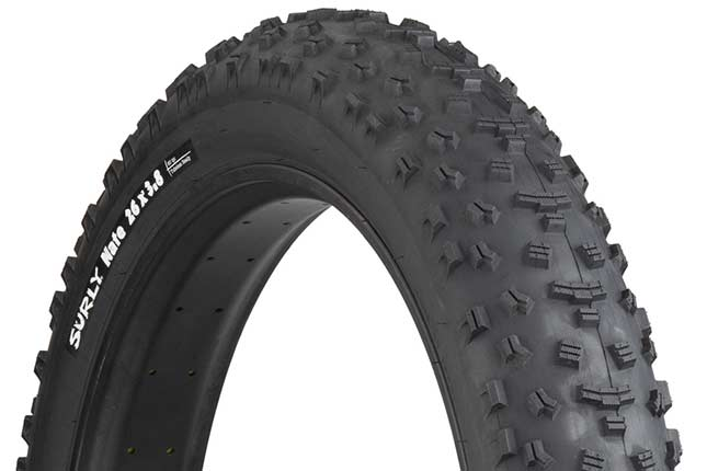 Surly Nate 26 x 3.8 inch fat bike tire mounted on rim showing tread and sidewall with white hot patch on white background