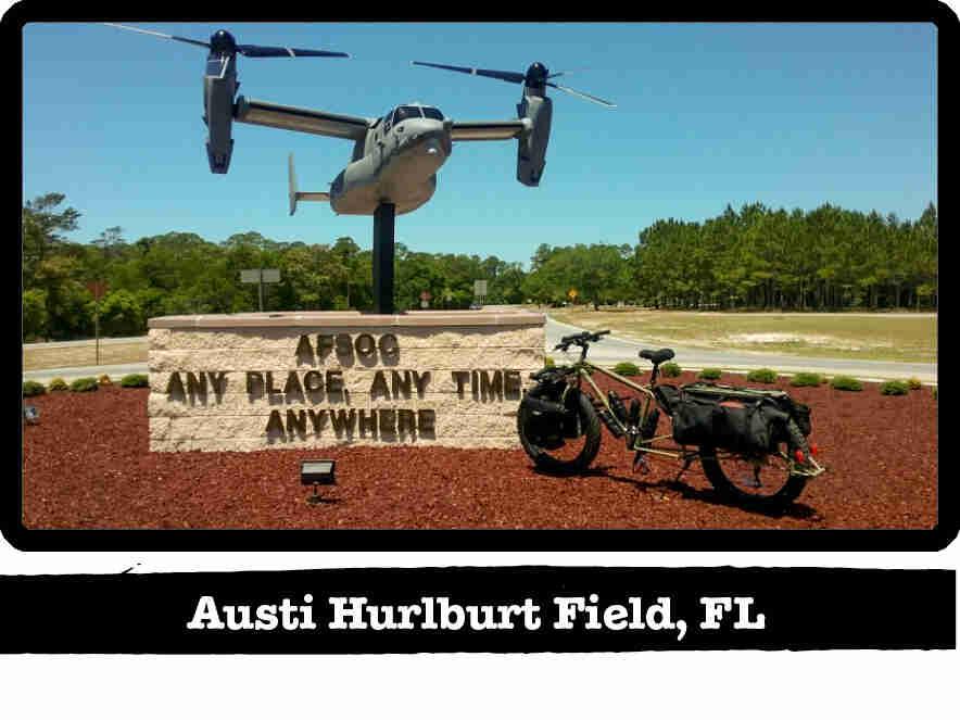 A Surly Big Fat Dummy bike in front of a AFSOC stone sign - Austi Hurlburt Field, FL tag below image