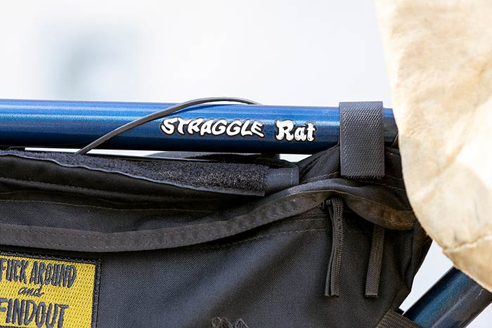 Close-up of frame bag with yellow patch applied and mix of Surly bike decals, 'Straggle®' and 'Rat'. The Rat decal from the Pack Rat bike