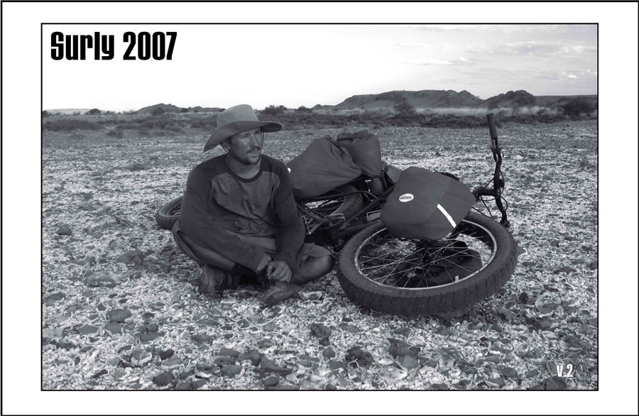 Surly Bikes - 2007 Catalog Cover - A cyclist, wearing a cowboy hat, sitting in the desert with a Surly fat bike