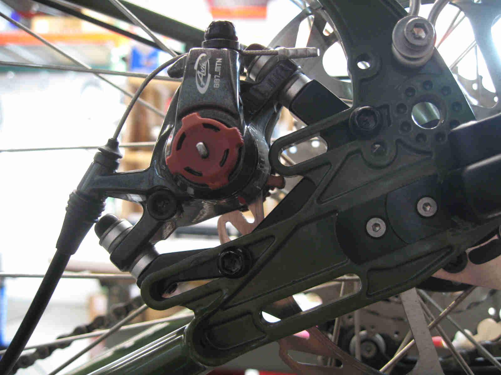 Surly Ogre bike - green - rear disc brake caliper detail - left side, close up view