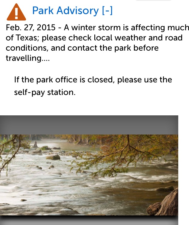 Screen shot of a Park Advisory message with an image of a flooded river below the text