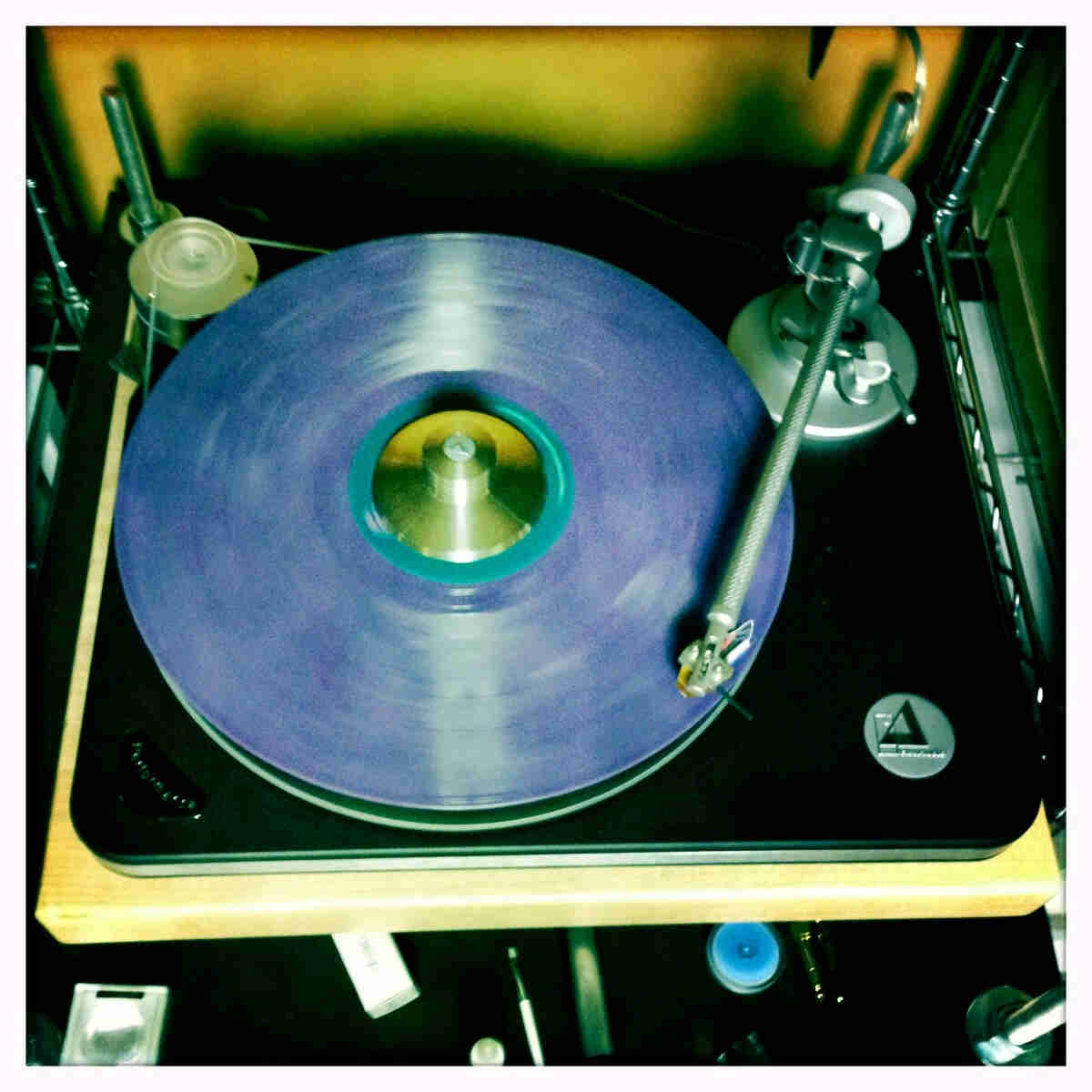 Downward view of a blue record album on a turntable