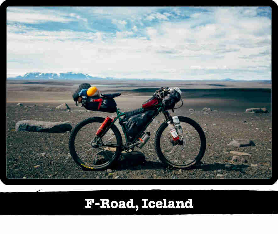 Right side view of a Surly bike, loaded with gear, on a flat gravel tundra - F-Road, Iceland tab below image