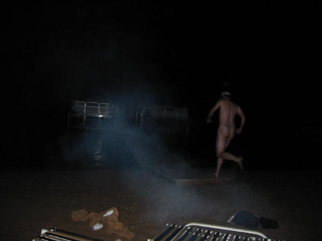 Rear view of a person streaking at night