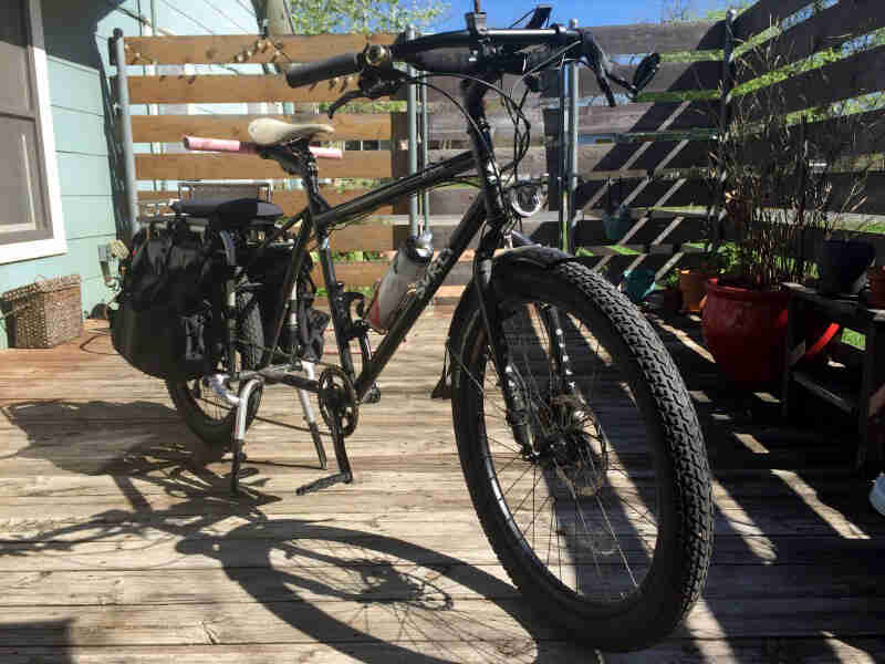 Front left side view of a Surly Big Dummy bike, parked on a deck at house