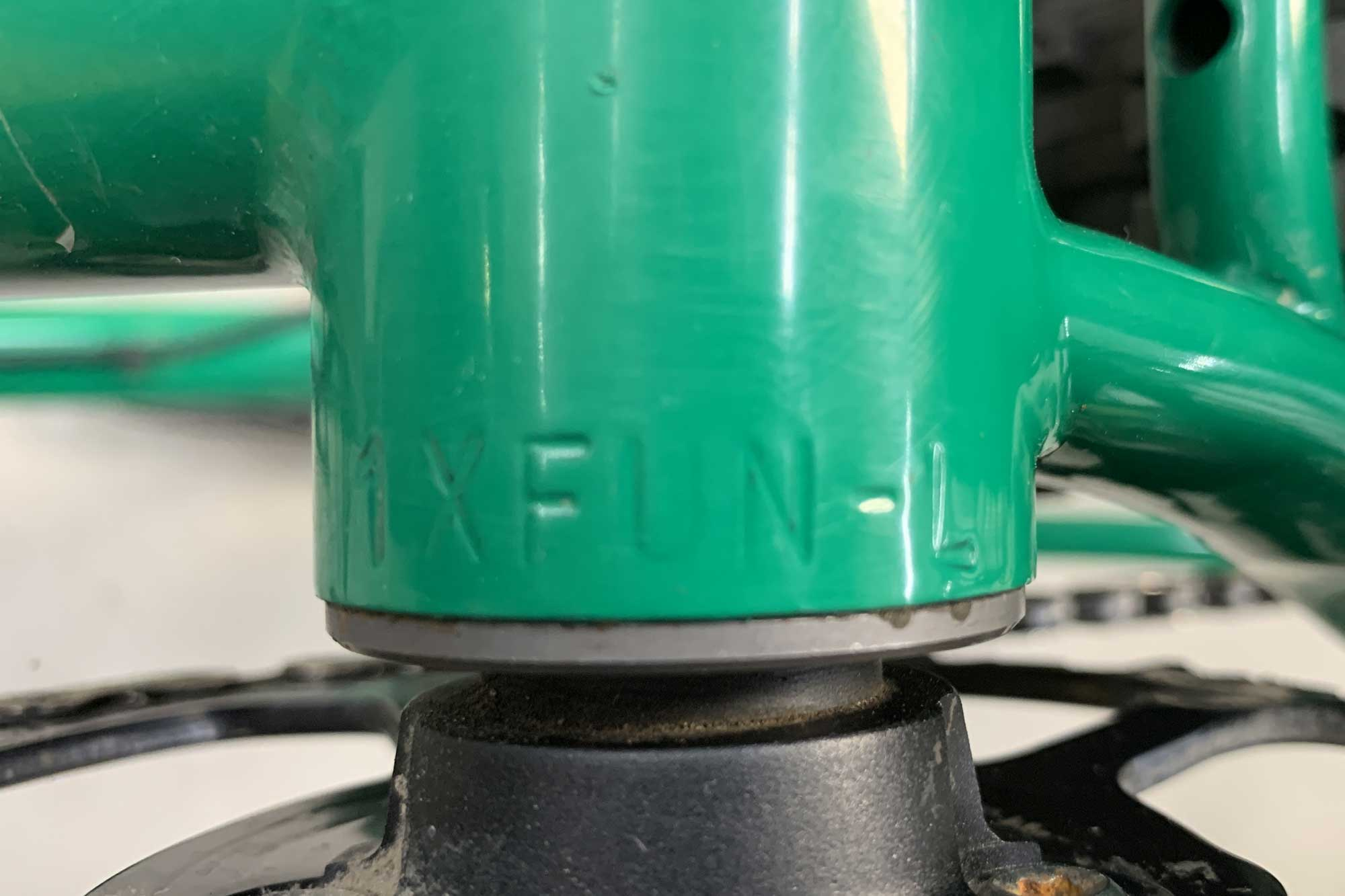 Close up view of the serial number on the bottom bracket a green Surly bike frame