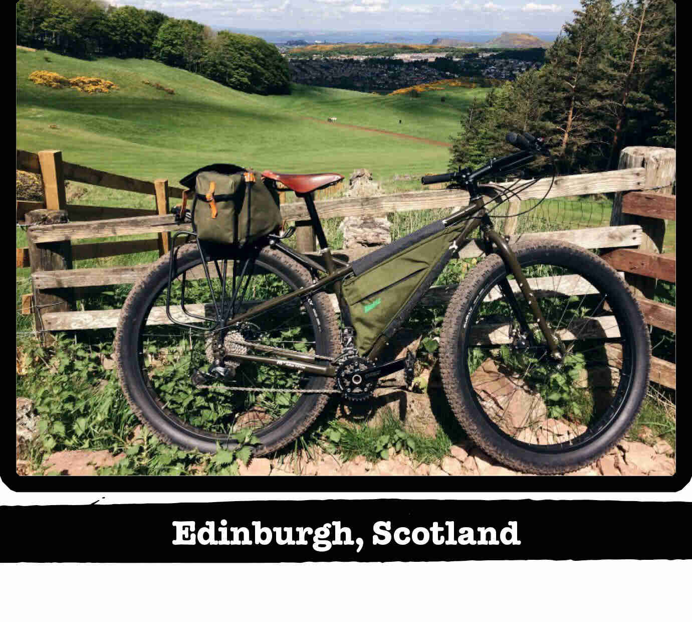 Right side view of Surly ECR bike, olive, against a wood fence - Edinburgh, Scotland tag below image