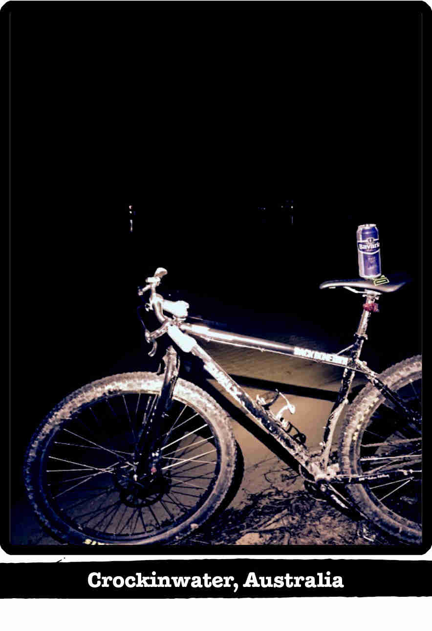 Left side view of a Surly Karate Monkey bike, black, at night in the sand - Crockinwater, Australia tag below image