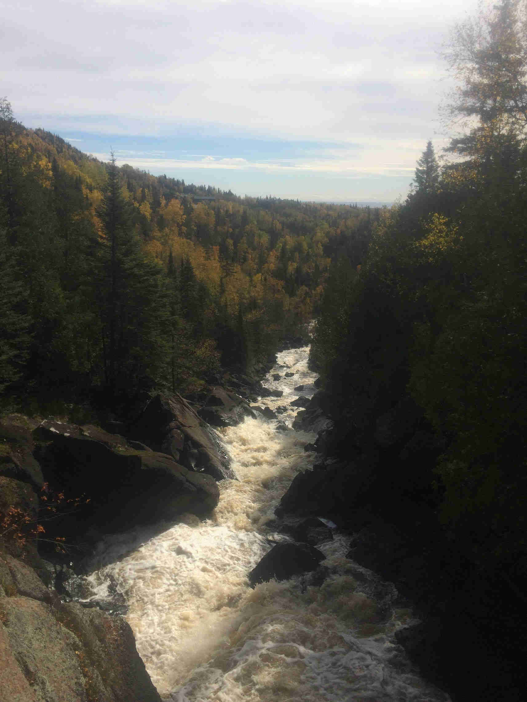 A raging river flowing down a gorge in the Superior National Forest