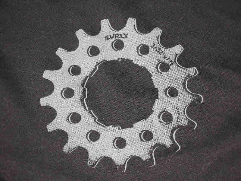 Close up view of a gray bike gear graphic from the back of a black Surly Full Zip Hoodie