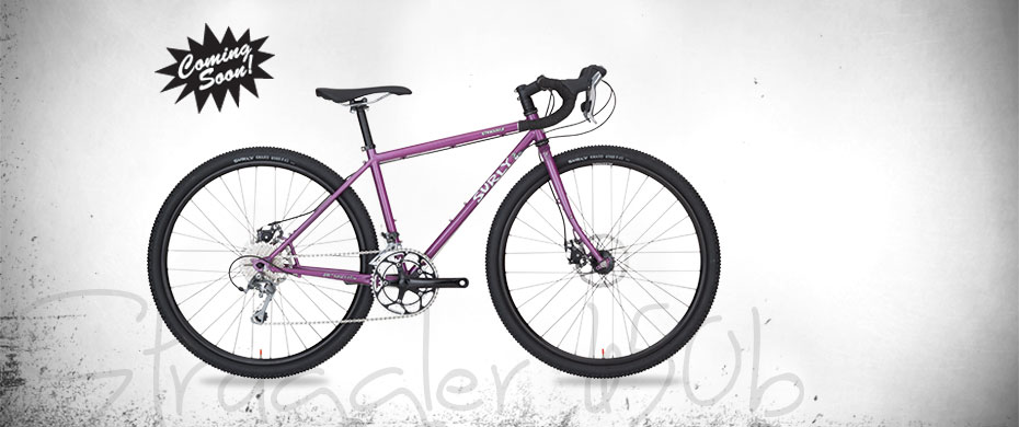 Surly Straggler 650b bike - purple - right side view - faded white background with a